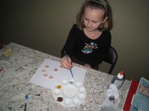 Sparkles painting her bowl game disks
