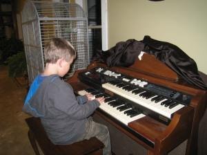 Middle Boy playing the organ