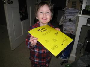 Littlest with his first preschool book