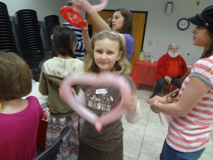 Sparkles at Valentine's Day party...is that Santa?