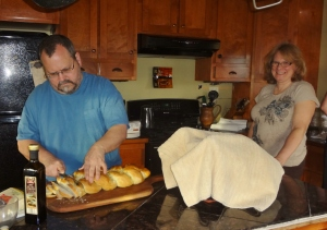 my husband and Mrs. Cuddle-me prepping the turkey feast