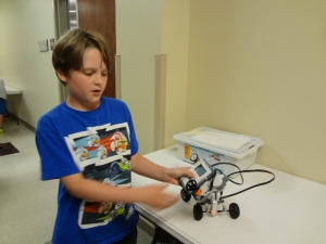 Oldest explaining his Lego Mindstorm projest