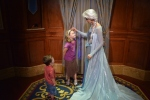 "Queen Elsa admiring Sparkles ""frosted"" headband"