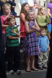 Middle Boy. Sparkles and Littlest in the children's choir