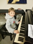 Middle Boy practicing at church