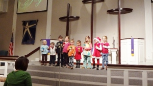 Little Ringers Bell Choir. Littlest is in the white vest.