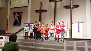 Little Ringers Bell Choir. Littlest is in the white vest.