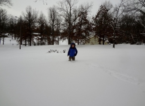 Middle Boy playing in snow