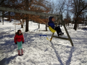 swinging in snow