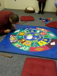 Tibetan Monk and world peace mandala