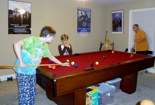 the boys learning to play pool
