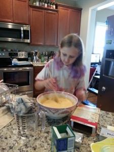 Sparkles making cake