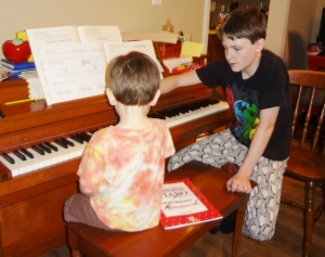 Littlest learning piano from Oldest